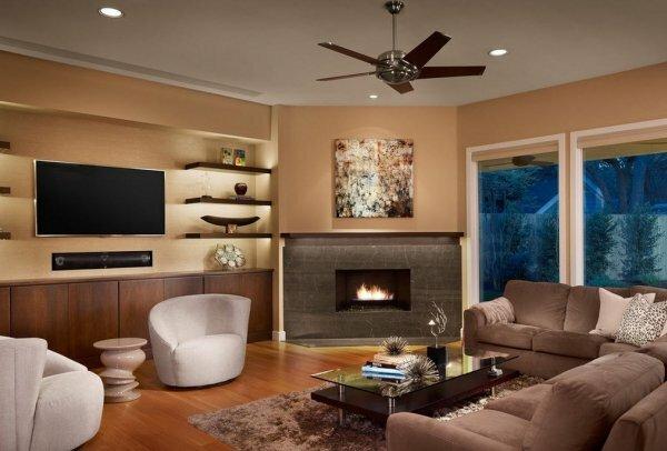 Угловой камин в интерьере современной гостиной