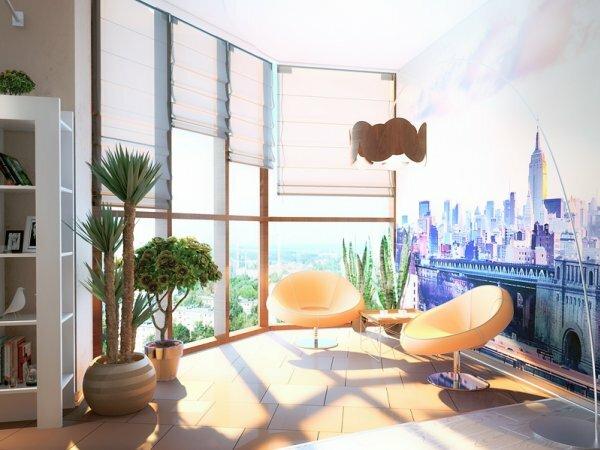 Если панорамный балкон объединить с комнатой, внутри можно сделать симпатичный уголок для себя