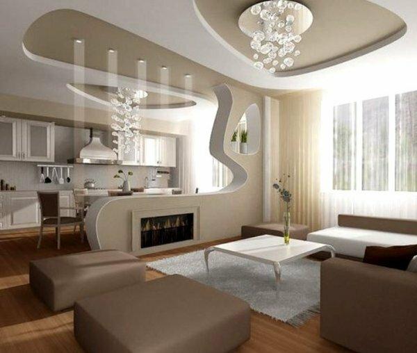 Разграничить пространство помогает часть декоративной стены с вмонтированным камином