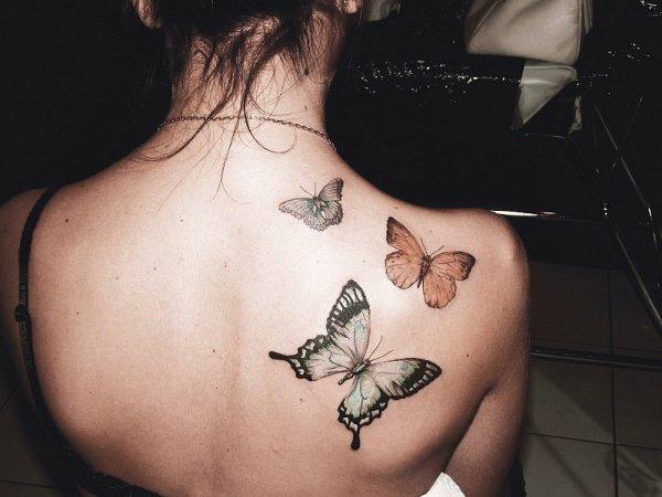 Разве можно пройти мимо такого фото с татуировкой в виде бабочек