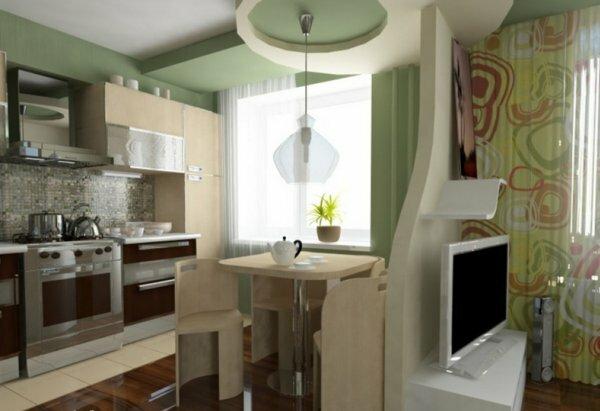Зеленый цвет стен кухни замечательно смотрится на фоне светло выкрашенной комнаты