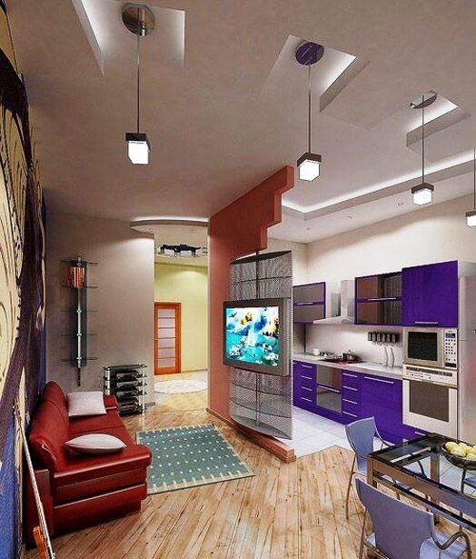 Кухня отделена от комнаты крутящейся стойкой с телевизором