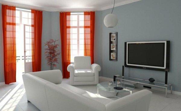 Когда комната выдержана в строгих цветах, чтобы сделать ее ярче можно выбрать полупрозрачные шторы огненного красного цвета